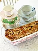 Cardamom cake in a paper dish