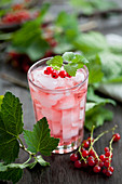 Redcurrant juice with lemon ice cubes