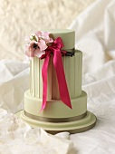 Wedding cake with a bow and flowers