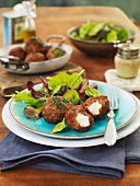 Meat balls with leaf salad