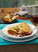 Fried pastry pockets stuffed with ground beef