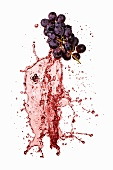 Red grapes with red wine splash