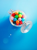 Colourful gobstoppers in a glass jar