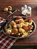 Breadcrumbed meatballs on salad