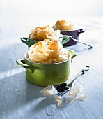 Apple dessert with filo pastry top in miniature cocotte dishes