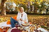 Woman at autumn picnic