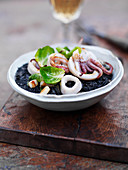 Black rice with grilled octopus and sprout leaves