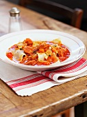 Chorizo and tomato stew with pasta