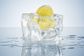 Half a lemon in a block of ice