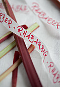 Ribbon with writing above rhubarb stems