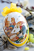 An Easter egg with a picture of rabbits