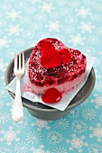 A small cheese cake with cherries and rose petals