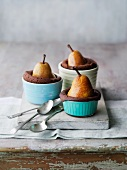 Chocolate souffles with pears