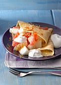 Pancakes with a melon and citrus fruit salad and caramel