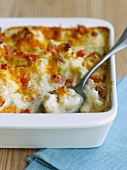 Cheesy Cauliflower Casserole in Baking Dish; Scoop Removed