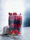 Fresh berries in a glass container