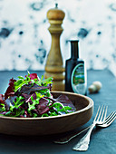 Mixed leaf salad in a wooden bowl
