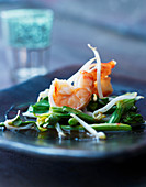 Prawns with bean sprouts on a bed of Asian vegetables
