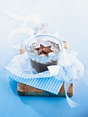 Chocolate cake in a glass decorated with a star