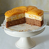 Mango and buttermilk cream cake, sliced