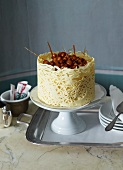 Vanilla mousse layer cake with caramelised hazelnuts