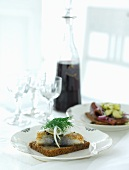 Wholemeal bread with fried herring, dill and onions for Christmas