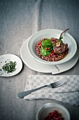 Risotto with pomegranate seed and a roast lamp chop