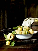 Fresh quinces with leaves