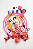 A homemade carnival clown