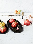 various heirloom tomatoes and garlic