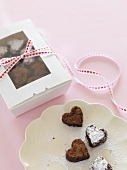 Chocolate hearts on a plate and in a gift box