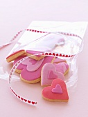 Pink heart-shaped biscuits with a gift ribbon