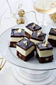 Chocolate cakes decorated with gold leaf for Christmas