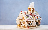 A gingerbread house decorated with sweets