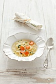 Chicken broth with egg noodles and carrots
