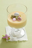 Egg cream with white chocolate and sugar eggs