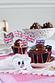 Chocolate Union Jack cupcakes on a table