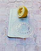 A citrus press and a lemon
