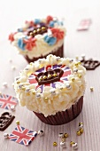 Cupcakes topped with cream and Union Jacks surrounded by chocolate crowns