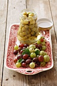 Gooseberry compote and fresh gooseberries