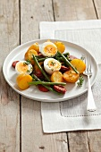 Warm potato salad with chorizo, green beans and egg