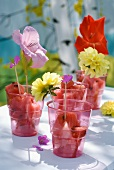 Chunks of watermelon in plastic cups decorated with flowers