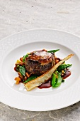 Stuffed oxtail with chanterelle mushrooms and peas