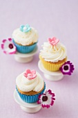 Three cupcakes decorated with flowers