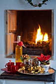 Mulled punch and snacks in front of open fire at Christmas