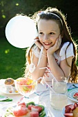 Girl smiling happily at birthday party
