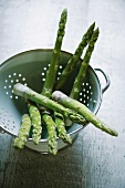 Green asparagus in a colander