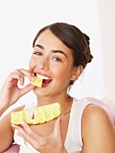 Woman eating pineapple