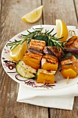 Grilled salmon and vegetables kebabs with rosemary