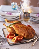 Roast goose with baked apples for Christmas